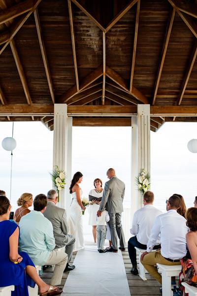 Wedding ceremony on the dock. The Villas at Banyan Bay, Ambergris Caye, Belize. Belize Wedding Photography by Leonardo Melendez Photography.