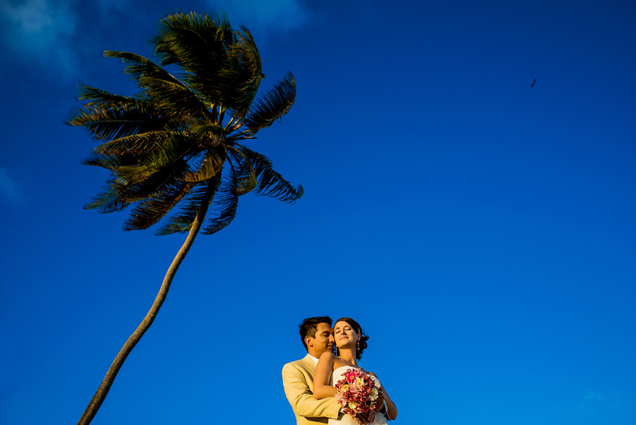 Blue skies and palm trees in Belize!  Coco Beach Resort Wedding.  Belize wedding photographers, Leonardo Melendez Photography.